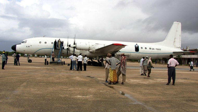 A chartered plane sits on the ground at Mogadishu International Airport on Sunday. The rare flight -- the first commercial flight in more than a decade -- illustrates the control of Islamic militants, who have seized the capital and much of southern Somalia, throwing the government into turmoil.