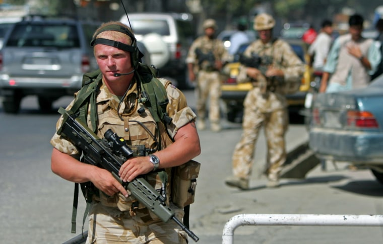 NATO-led British soldiers patrol a street in Kabul