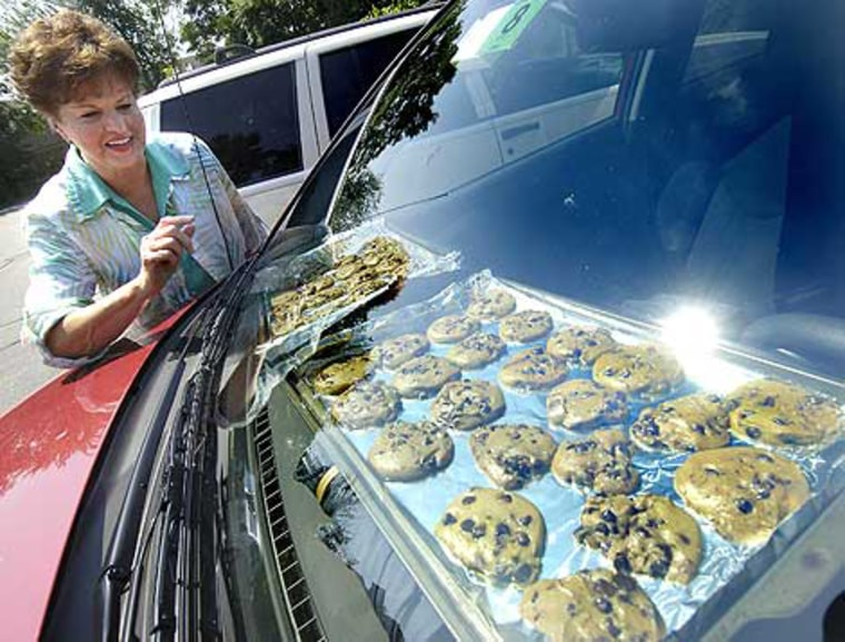 Sandi Fontaine bakes cookies on the dashboard of her SUV in Bedford on Wednesday.