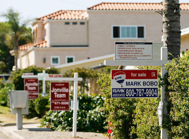 Real estate signs advertise the sale of three homes in a row in Encinitas, Calif. last week. As California's housing market slows, year-over-year prices in San Diego County fell in June for the first time since the state's housing boom began there six years ago.