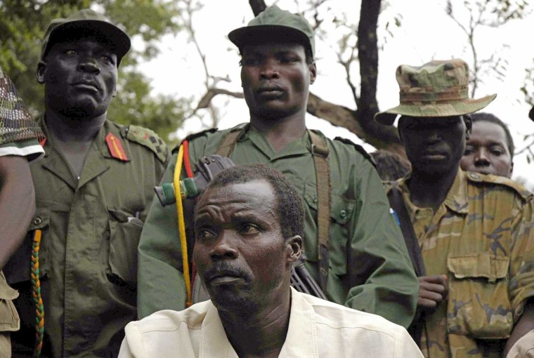 The leader of Uganda's Lord's Resistance Army rebels Joseph Kony (in white) addresses his first news conference in 20 years of rebellion in Nabanga, Sudan, August 1, 2006 where he called on a ceasefire with the government as a prelude to peace talks.