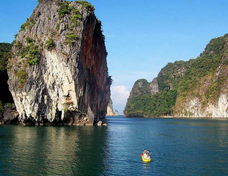Sea kayaking in the Andaman Sea, off of Phuket, Thailand, with John Gray tours.
