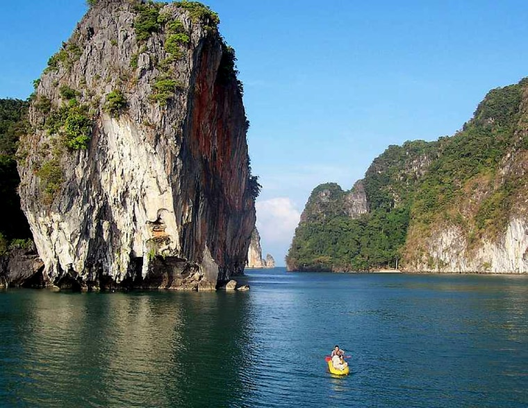 Sea kayaking in the Andaman Sea, off of Phuket, Thailand, with John Gray tours.