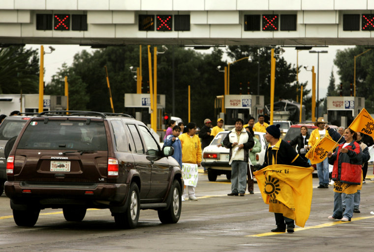 Supporters of leftist Andres Manuel Lopez Obrador got the attention of drivers on Tuesday by taking over toll booths around Mexico City.