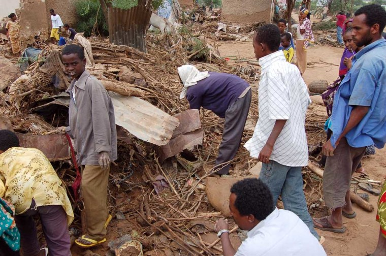 Ethiopian trying to remove debris left after a flash flood swept through the Afetesia slum, Monday in the far eastern Ethiopian city of Dire Dawa. More than 200 people are dead and officials estimate up to 300 more are unaccounted for or missing.