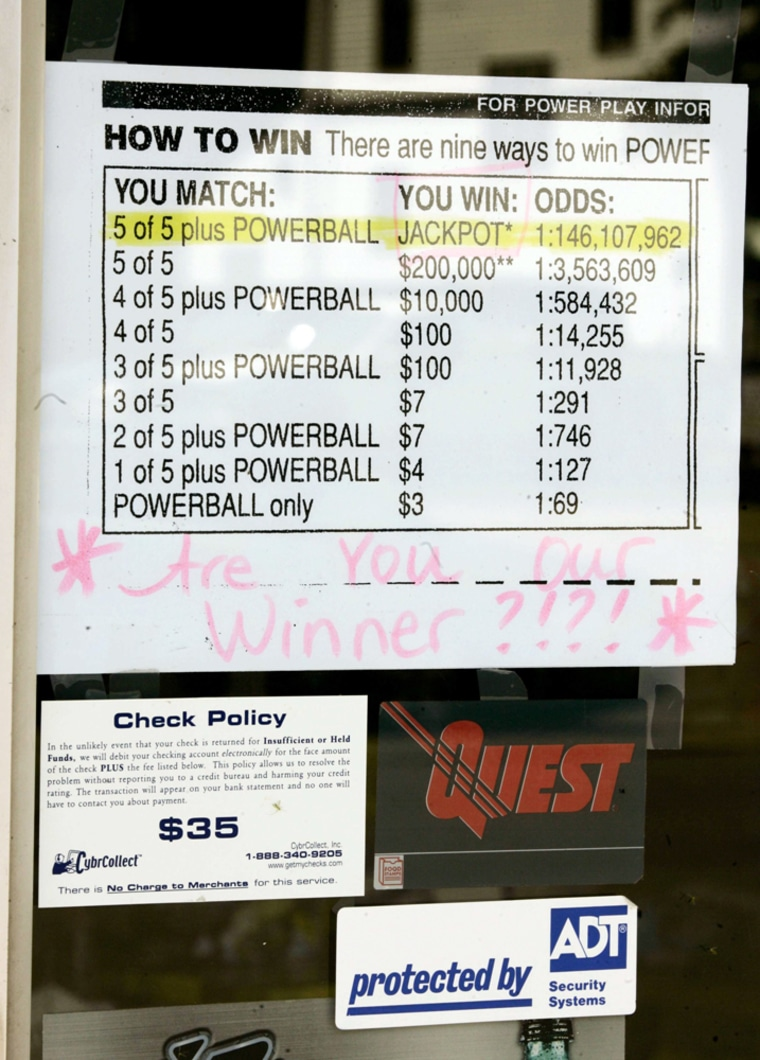 A sign on the door of Ma & Pa's Grocery Express in Fond du Lac, Wis., lists the winnings for a lottery ticket worth $208.6 million on Monday.
