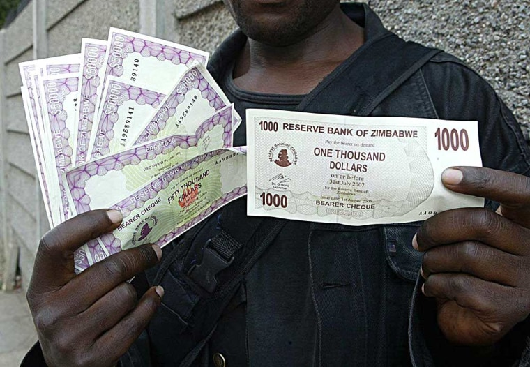 A resident of Zimbabwe displays a newly unveiled bank note on the streets of Harare on Aug. 1. Zimbabwe's Reserve Bank slashed three zeroes from its currency last weekto help consumers battlingrapid inflation.