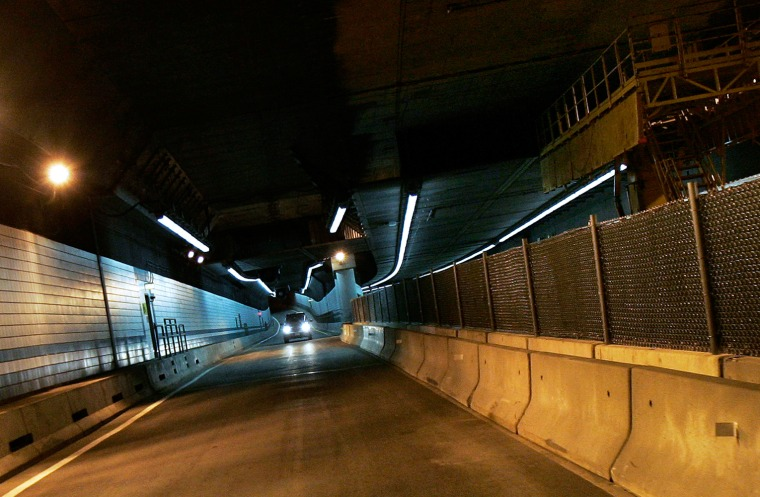 Concrete barriers with fencing divide the newly re-opened Big Dig tunnel from areas still under repair in Boston, on Wednesday, after itthe tunnel wasopened to traffic.