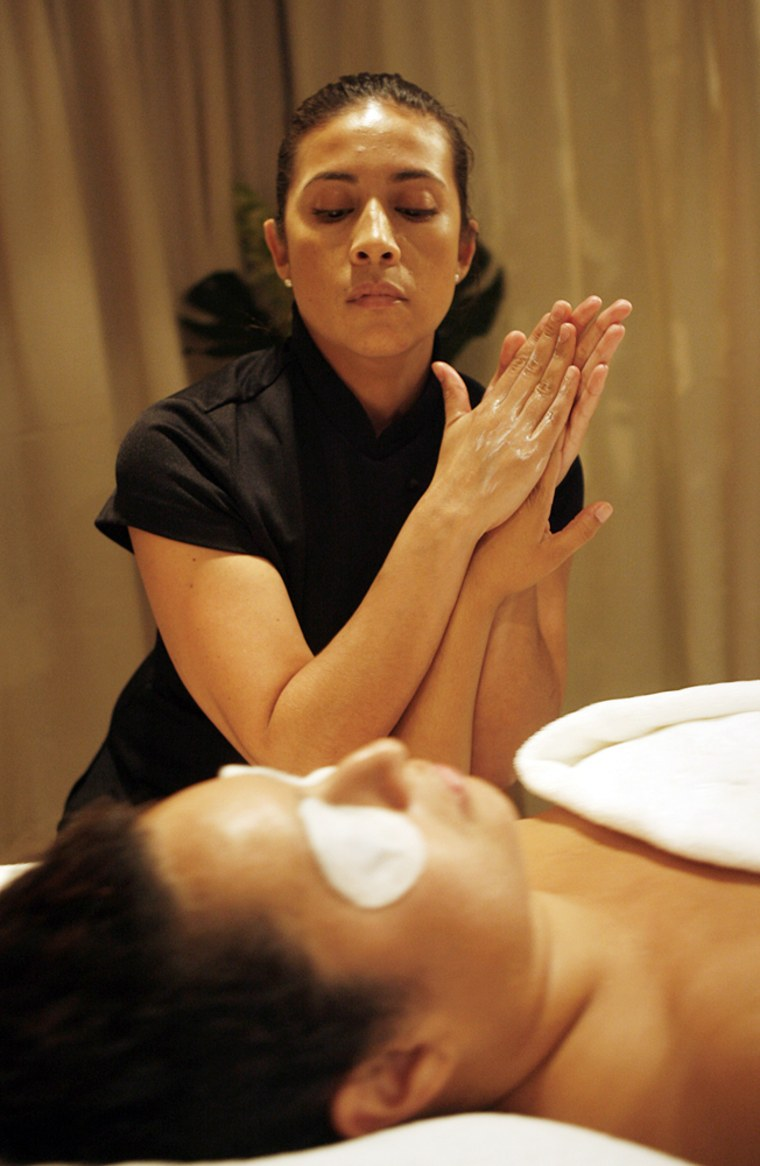 Massage therapist Nicole Yie demonstrates the Mandarian Oriental's 'Awaken Facial' on Lissette Hesmadt during the annual meeting of the International Spa Association July 27, in New York.