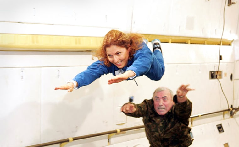 American entrepreneur and space tourist Anousheh Ansari gets a push during weightless training aboard a modified aircraft. Ansari is training as a backup for Japanese space tourist Daisuke Enomoto, and is in line to become the world's first female private spaceflyer.