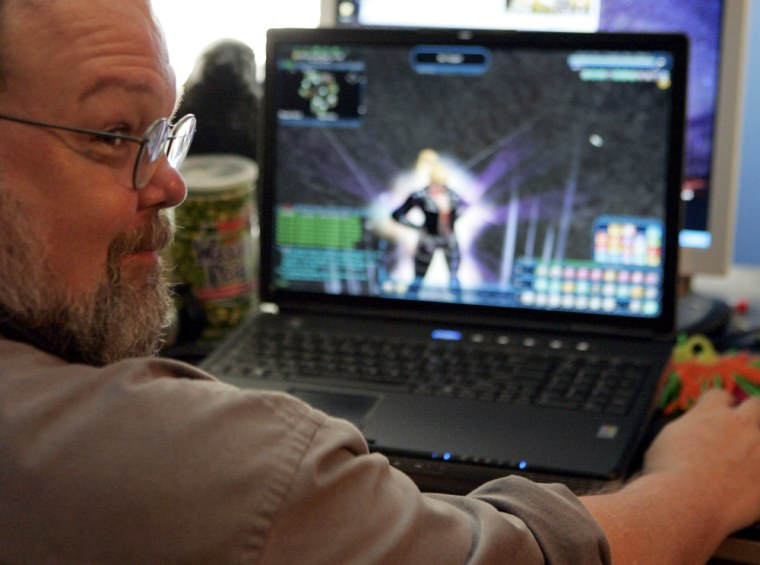 Freeman Williams sits in front of his home computer in Houston with his virtual alter-ego, video game super hero Robotrixie, on the screen.