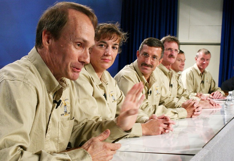 Canadian Space Agency astronaut MacLean answers question during STS-115 crew news conference