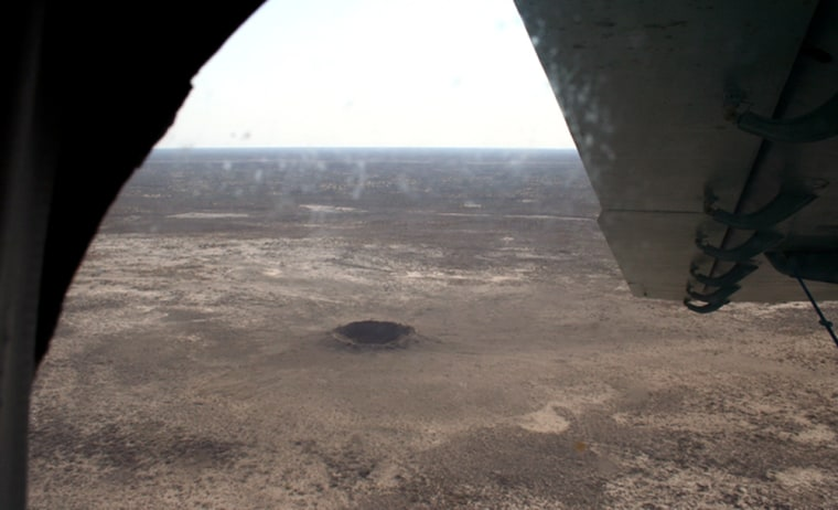 An aerial view of the Kazakh steppes revealsa cratercreated by the crash of debris from a Russian Dnepr rocket last month.