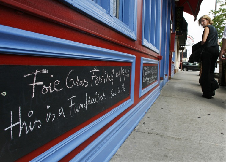 A chalk board outside Chef Didier Durand's Cyrano's Bistrot and Wine Bar in Chicago advertises an upcoming Foie Gras Festival Wednesday.