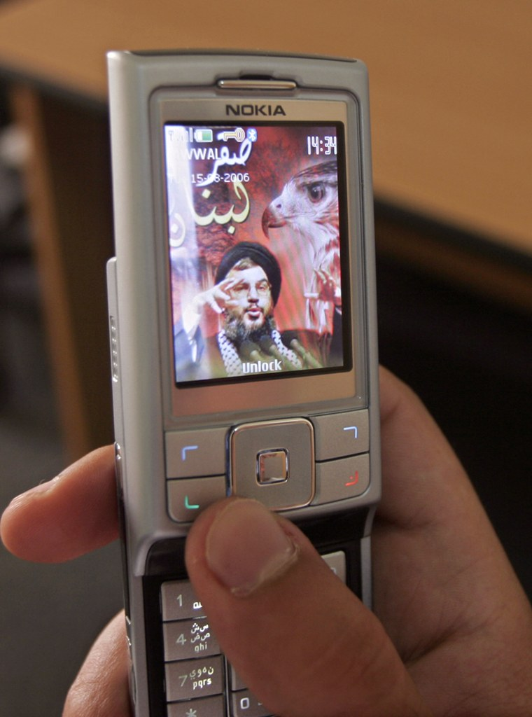 An image of Hezbollah leader Sheik Hassan Nasrallah is used as a mobile phone's screen saver in the West Bank town of Ramallah on Tuesday.