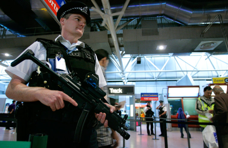 Armed British police officers patrolLondon's Heathrow Airport onMonday.