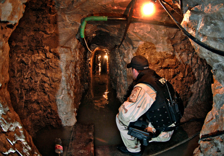 A U.S. Immigration and Customs Enforcement agent looks down a shaft of a tunnel leading from the U.S. into Mexico in this Jan. 30 file photo. Federal agents have arrested Mexican drug lord Francisco Javier Arellano-Felix, a leader of a major violent gang accused of digging the tunnels.