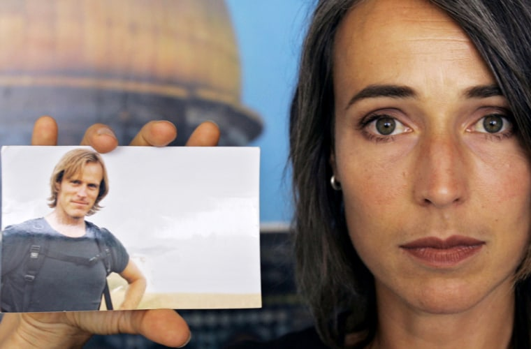 Anita McNaught holds a picture of her husband Olaf Wiig, 36, a Fox News cameraman from New Zealand who was kidnapped in Gaza City.