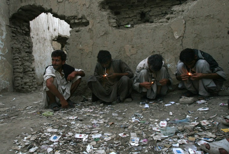 Afghans smoke opium in Kabul, Afghanistan, in this Aug. 11 photo.Opium cultivation in Afghanistan has hit record levels — up by more than 40 percent from 2005.