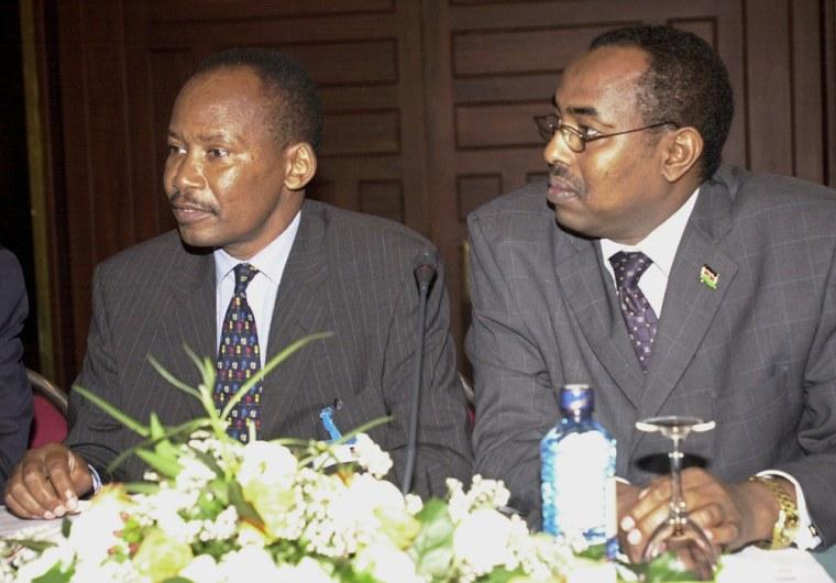 Jeremiah Kianga, Kenya's Chief of General Staff, left, and Mohammed Abdi Affey, Kenya's Ambassador to Somalia, confer Thursday duringa meeting in Nairobi.