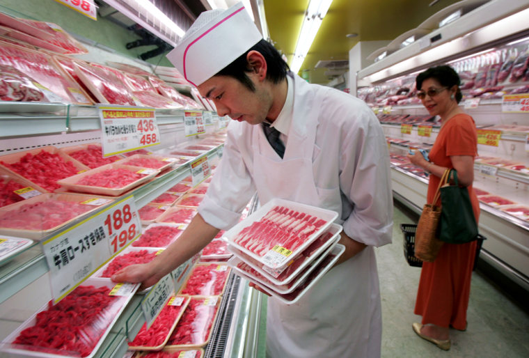 Sales clerk chief Tomohiro Kuriki arranges packs of beef imported from Canada and Australia at Hanamasa Co., a Tokyo-based operator of supermarkets and restaurants.
