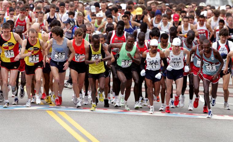 Men elite runners take off from the starting line of the Boston Marathon in Hopkinton, Massachusetts