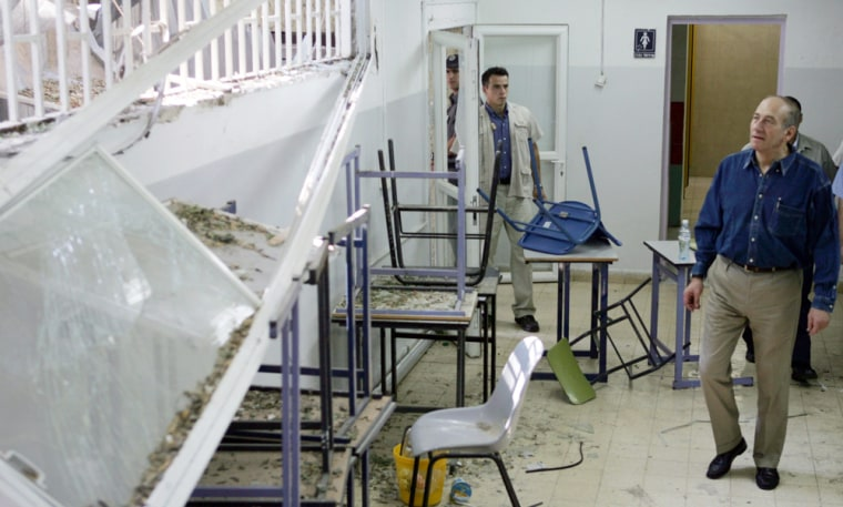 Israel's Prime Minister Olmert inspects a damaged classroom in Kiryat Shmona