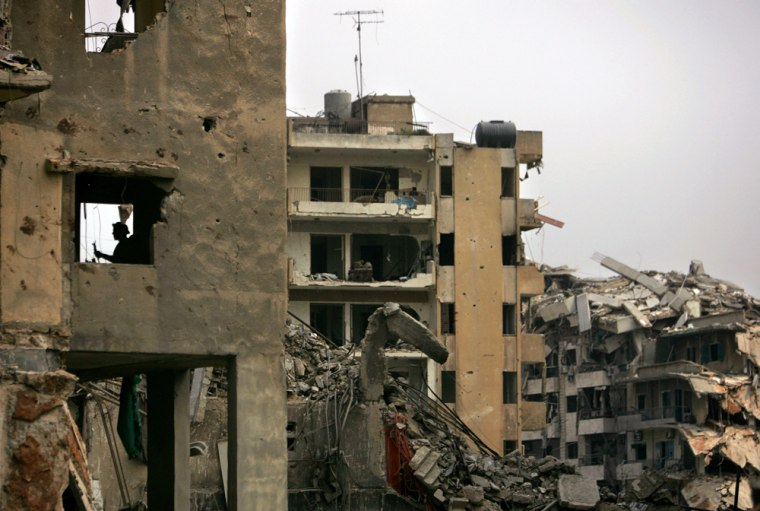 A Lebanese man stands in his apartment, which wasdestroyed by the Israeli bombardment.