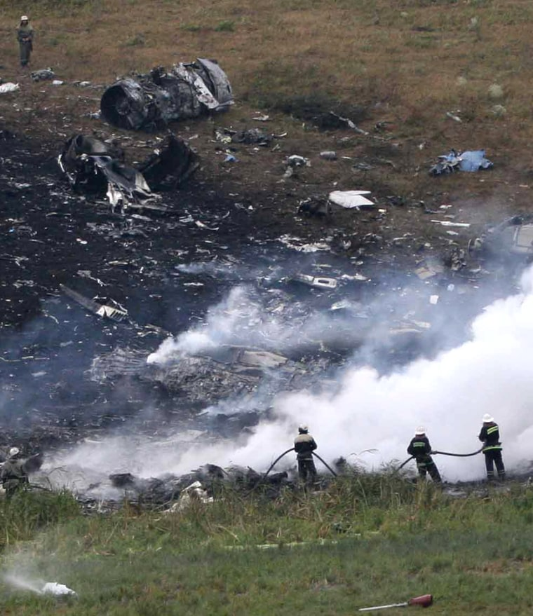 Firemen work at the site of the Russian