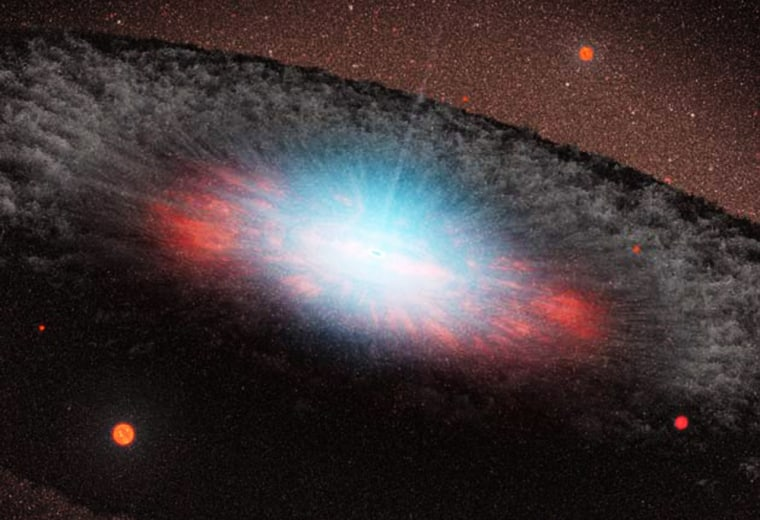 An artist's conception shows a supermassive black hole at the center of a galaxy. Blue color represents radiation pouring out from material very close to the black hole. The grayish structure surrounding the black hole, called a torus, is made up of gas and dust. Beyond the torus, only the old red-colored stars that make up the galaxy can be seen. There are no new stars in the galaxy.