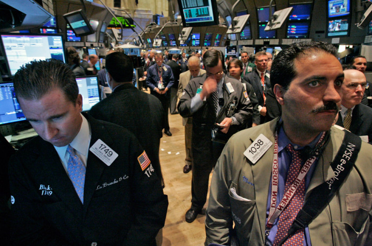 Workers on the floor of the New York Stock Exchange observe a moment of silence before Monday's opening bell to observe the fifth anniversary of Sept. 11, 2001.