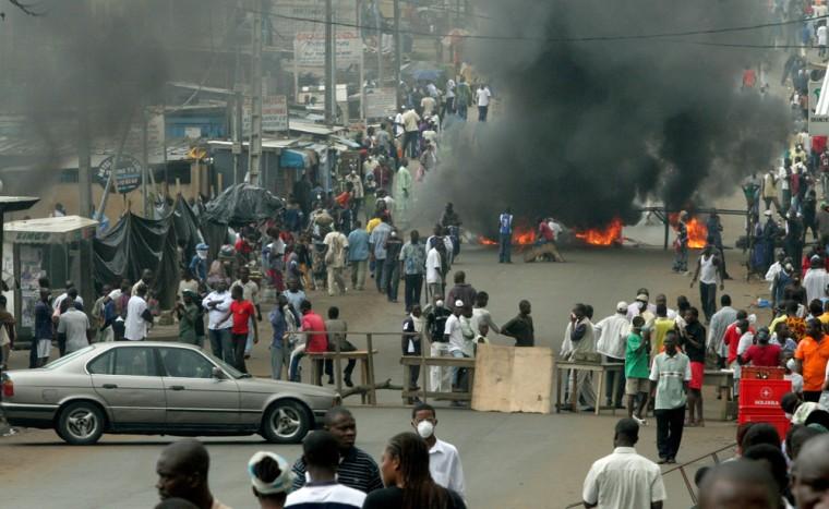 Protestors erect roadblock and light bonfire in Ivory Coast's economic capital Abidjan