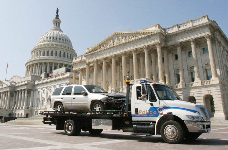 A vehicle that breached a barricade at the Capitol is towed away on Capitol Hill in Washington, D.C., on Monday.