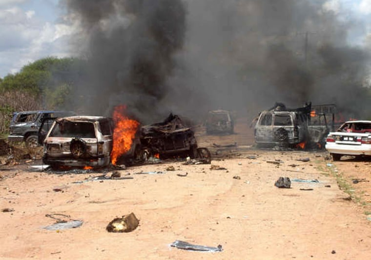 Wreckage litters a street shortly after a bombing that killed 11 in Baidoa, Somalia, on Monday.