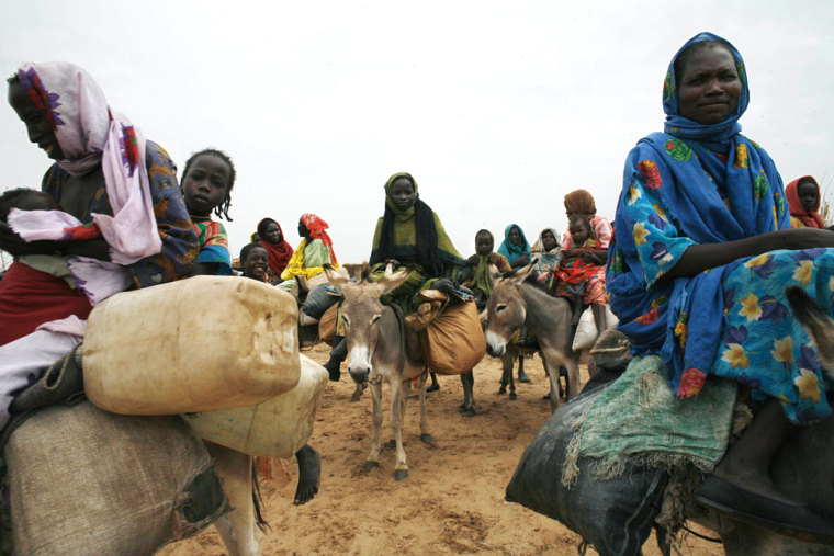 New arrivals pass through Largo Camp in Tawilla, Sudan in early September on their way to the safer Rawanda Camp - which is closer to the small African Union Camp.