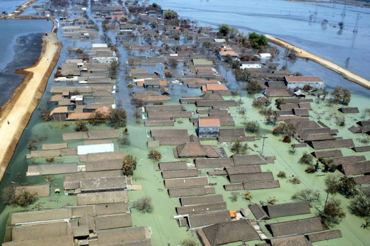 Aerial view shows houses flooded with mud in Sidoarjo in Indonesia's East Java province