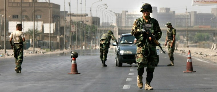 The Iraqi army mans a checkpoint in Baghdad on Saturdayafter the Iraqi government ordered a ban in Baghdad to pedestrian and car traffic through Sunday morning.