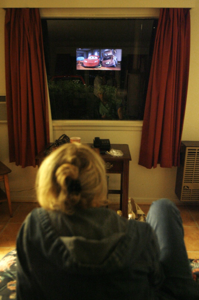 A patron watches from a room during the feature at the Fairlee Motel & Drive-In Theater in Fairlee, Vt. earlier this summer. At the Fairlee Motel & Drive-In Theater, you can drive in and have a classic outdoor experience, or check in and take in the same show from your king-size bed.