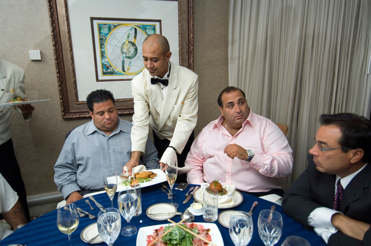 High rollers Nick Varano, center, and Ralph Ventola, left, sit with Frank Playo, their host at Foxwood Casino while they eat like kings earlier this summer.