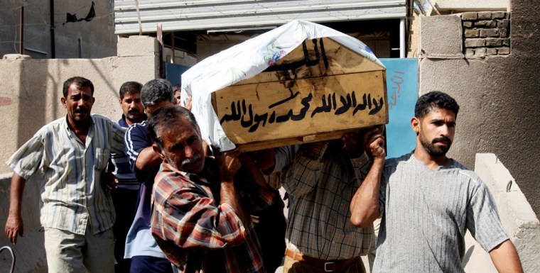Relatives carry the coffin of Faisal Murtada outside a Baghdad hospital on Tuesday. Murtada, a handyman, was killed with two of his colleagues by unknown gunmen.