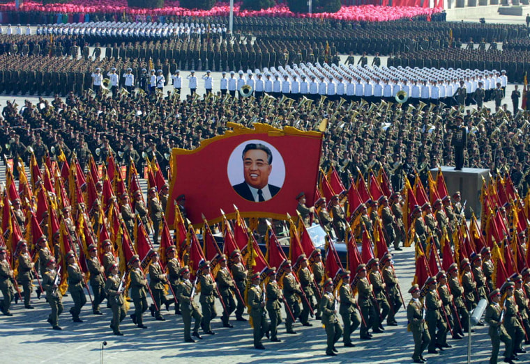 North Korean soldiers parade with the portrait of Kim Il Sung, the country's founding president, in Pyongyang to mark the 60th founding anniversary of the ruling Workers' Party in this October 2005 photo.