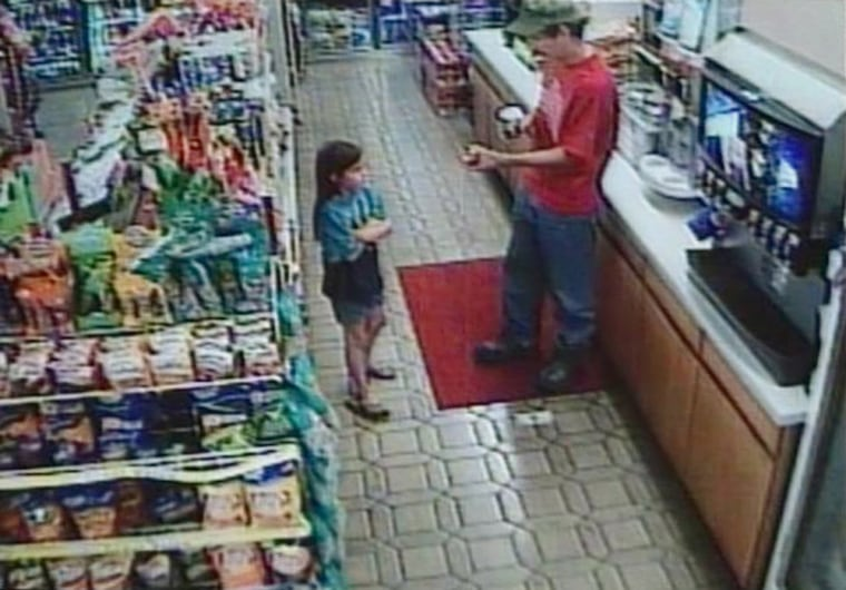 In this image taken from a security camera video, Shasta Groene and her alleged abductor, Joseph Edward Duncan III, are seen inside a convenience store, on July 1, 2005, in Kellogg, Idaho, hours before she was rescued.
