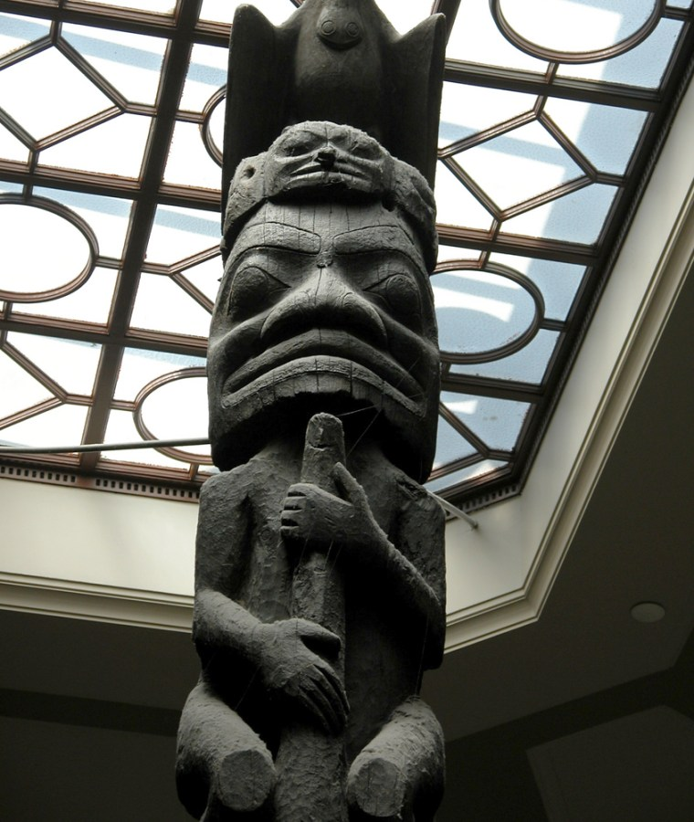 A totem pole extends towards the skylight in the main stairwell of the Royal Ontario Museum.