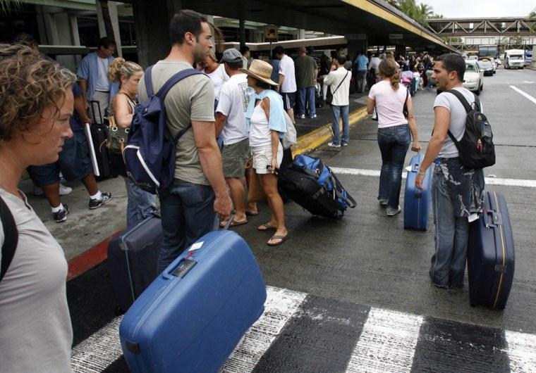 People wait outside Honolulu International Airport