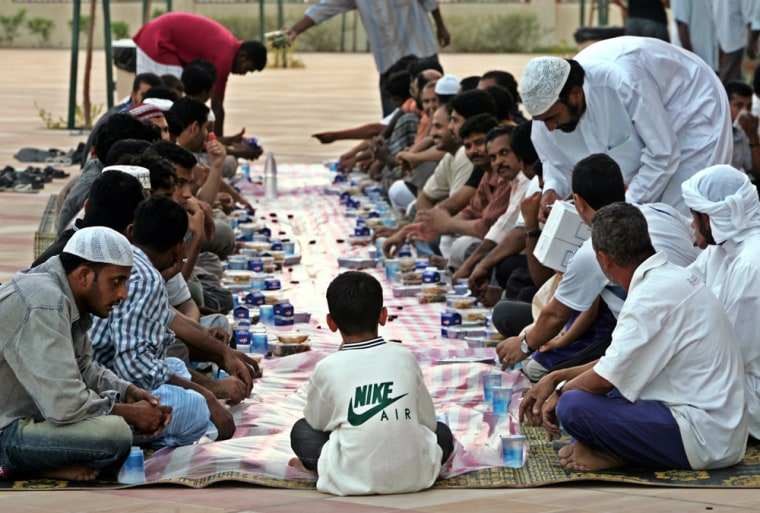 Muslims wait to break their fast with Iftar, the evening meal, during the Islamic holy month of Ramadan at a mosque in Dubai on Oct. 8.