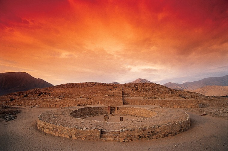The ruins of Caral, dating back to 2600 B.C., are spread out beneath the sky in Peru. Caral was once a thriving city, but the civilization that built it fell prey to a series of natural disasters, scientists say.