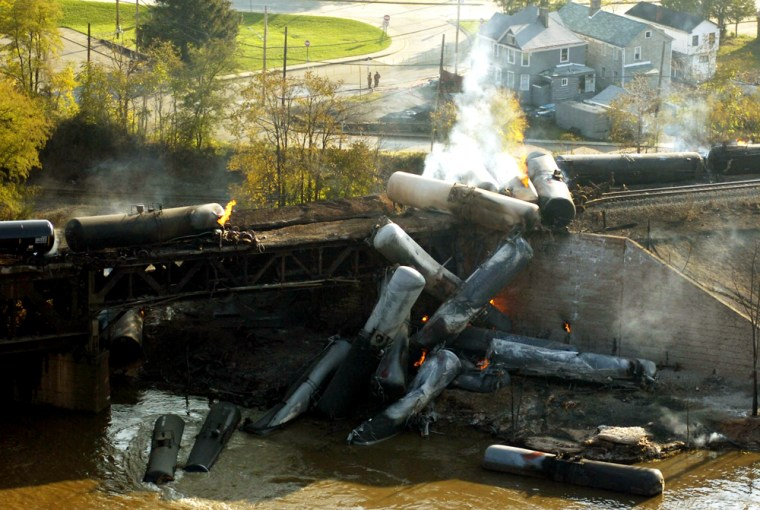 Flames and smoke rise Saturday from a derailed Norfolk Southern train in New Brighton, Pa. Twenty-three cars containing ethanol derailed on a bridge over the Beaver River in New Brighton, about 25 miles northwest of Pittsburgh, onFriday night.