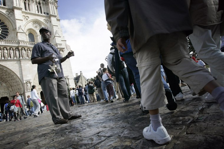 A street vendor sells Eiffel Tower souve