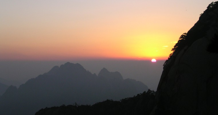 A sunset is seen over Huangshan, or Yellow Mountain, in this Oct. 2005 photo in southeast China.