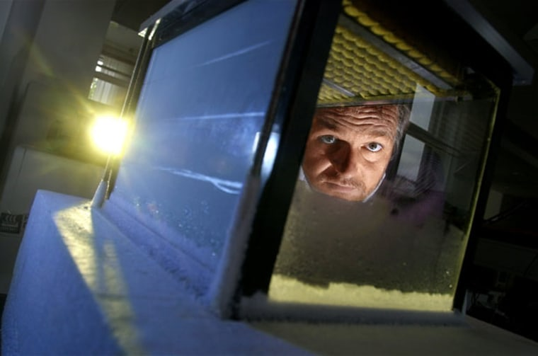 Henrik Svensmark, head of the research team at the Danish National Space Center, looks through a small cloud chamber.